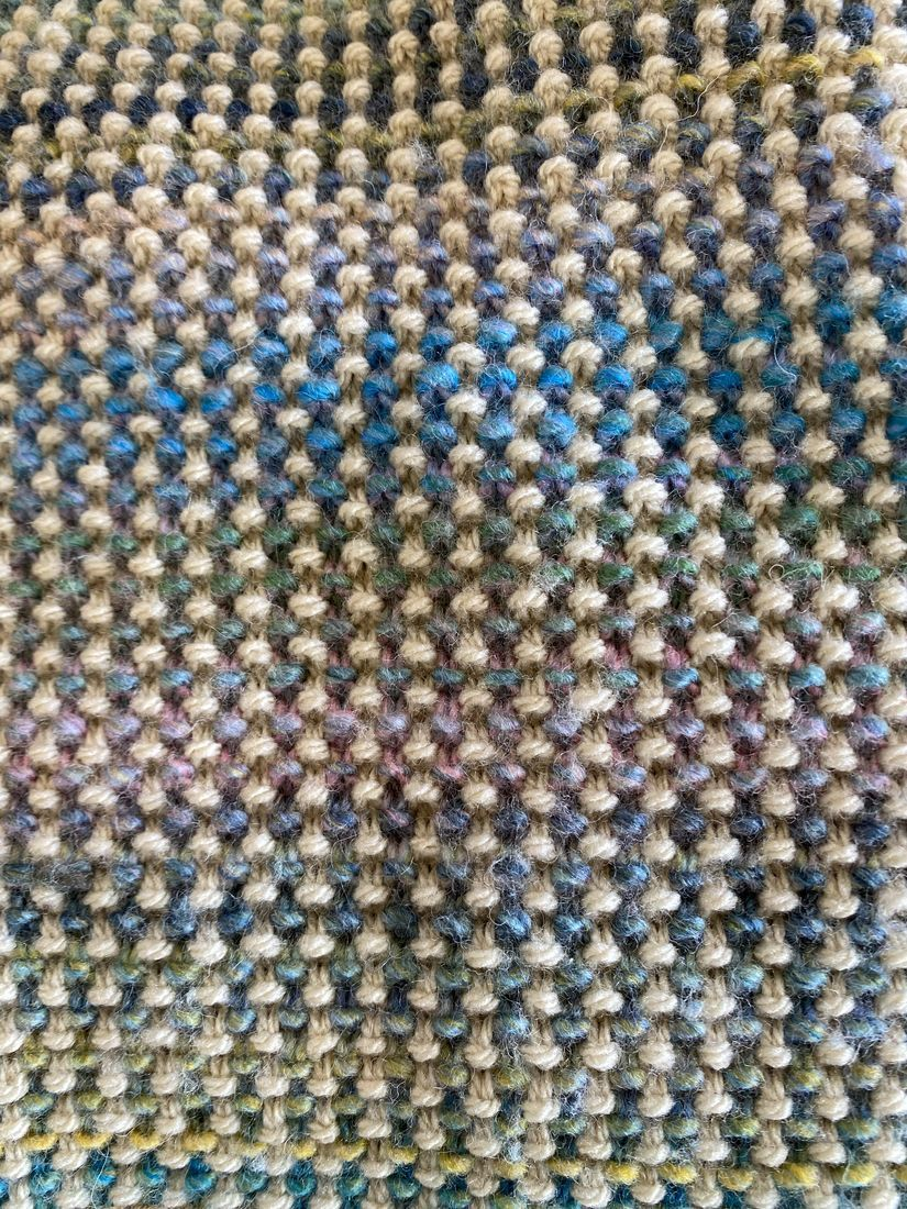 Close up picture of moss stitch