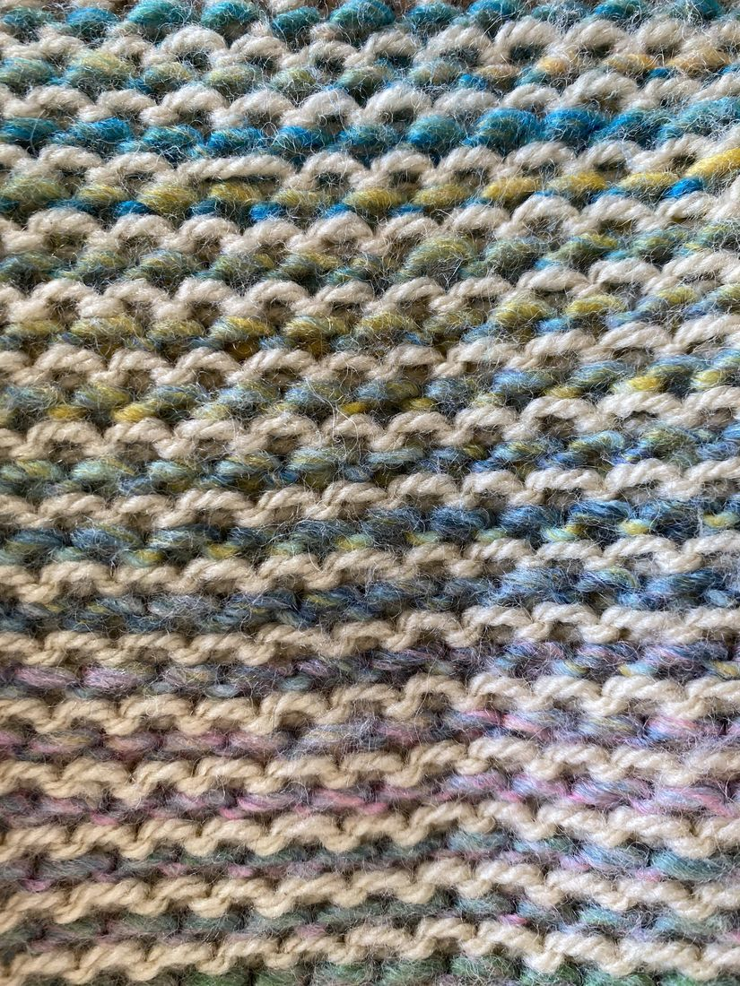 Close up image of wrong side of knitted fabric