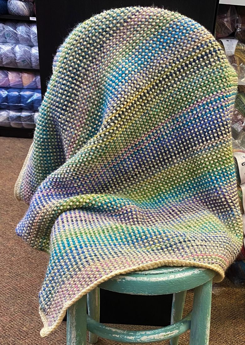 Moss stitch blanket on a chair